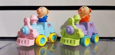 Заводная игрушка свинка на паровозике - фото 15441